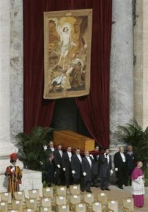 The coffin is borne into Saint Peter's Square